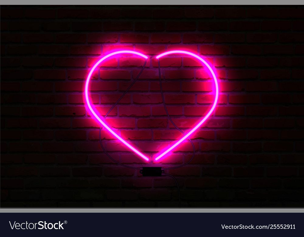 Pink glowing neon heart on brick wall background. Vector