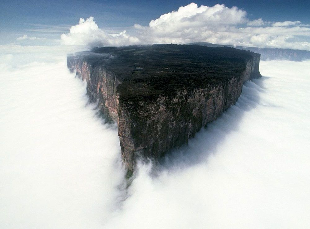 Mount Roraima, South America This tabletop mountain is one of the oldest mountains on Earth, dating back two billion years when the land was lifted high above the ground by tectonic activity. The sides of the mountain are sheer vertical cliffs, with several waterfalls, making it nearly impossible to climb.