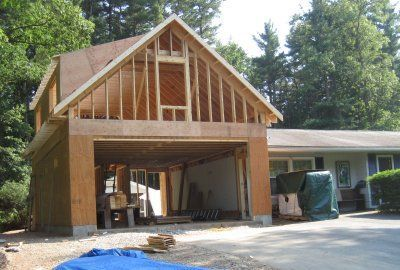 Expand your living space with an above garage addition for Garage designs with living space above