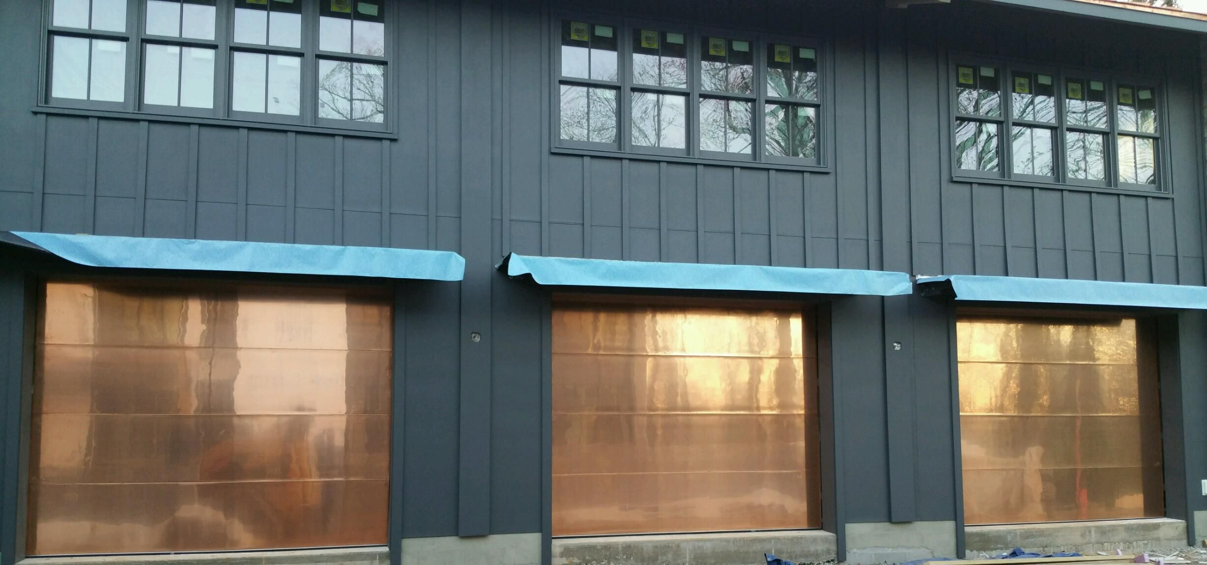 Three 10x8 Wooden Flush Copper Cladded Garage Doors Installed By