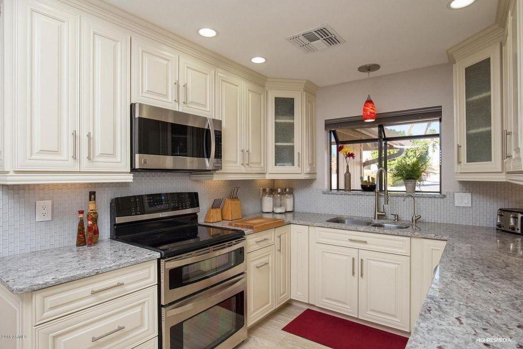 Captivating Kitchen With Garden Window, Andino White Granite Countertop, Wilmington  Raised Panel Cabinet Door