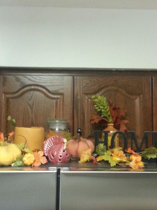 Fall decor above fridge