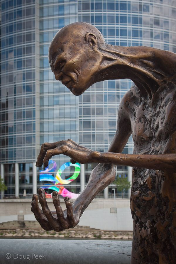 Art Prize Grand Rapids MI. Bronze Searcher holding art applied to window of J.W. Marriott 100 yards away.