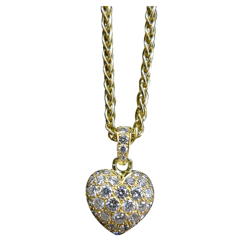 Cartier diamond yellow gold heart pendant on a cartier chain the