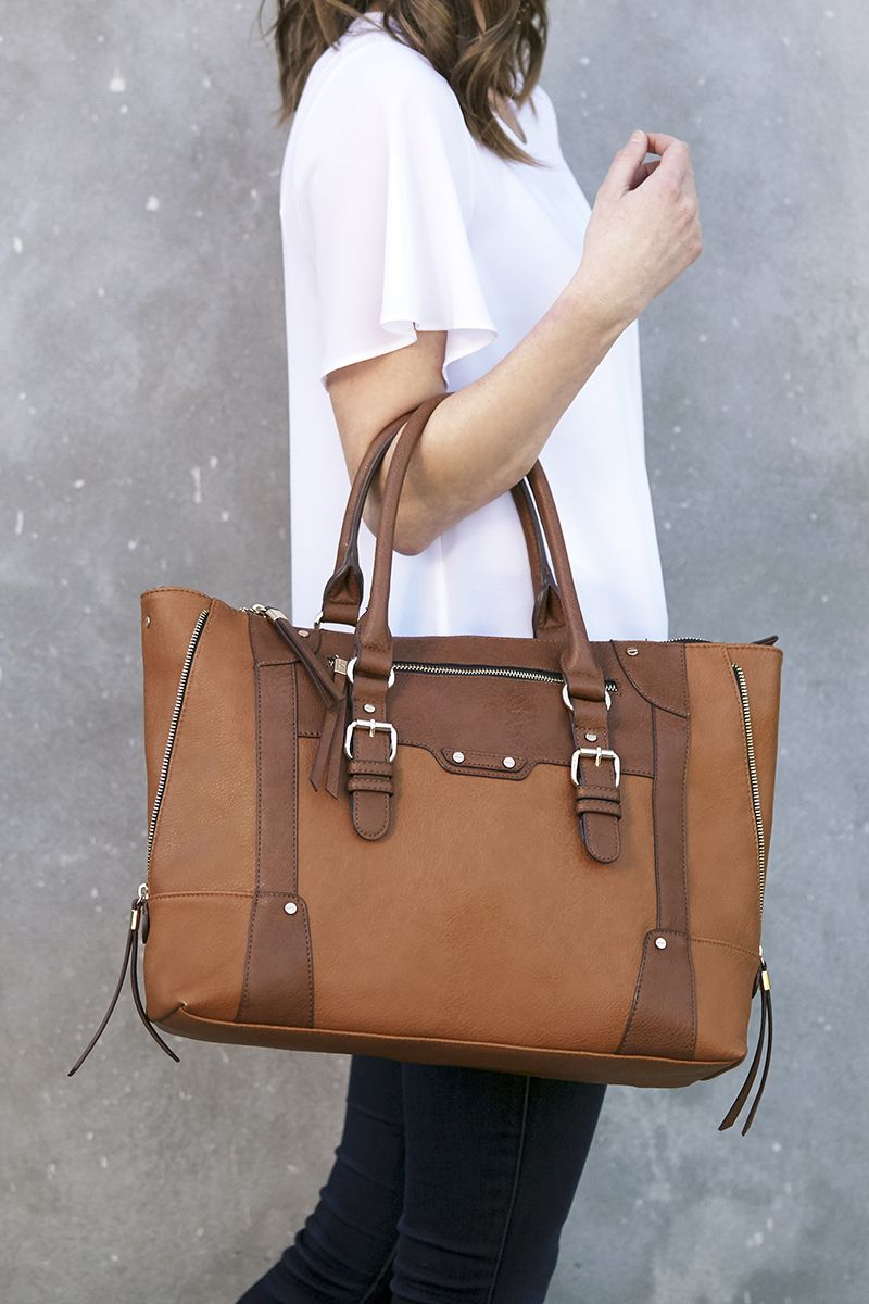 7e7db066903 Stylish and spacious, this winged tote bag has exposed zippers and hardware  detailing. The Susan Tote is perfect for carrying all of your essentials.