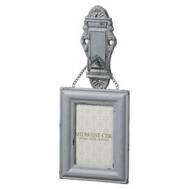 Distressed metal picture frame hanging on a faux key in lock.  Product: Picture frameConstruction Material: MetalColor: WhiteDimensions: 14.75 H x 6.125 W x 4.125 D