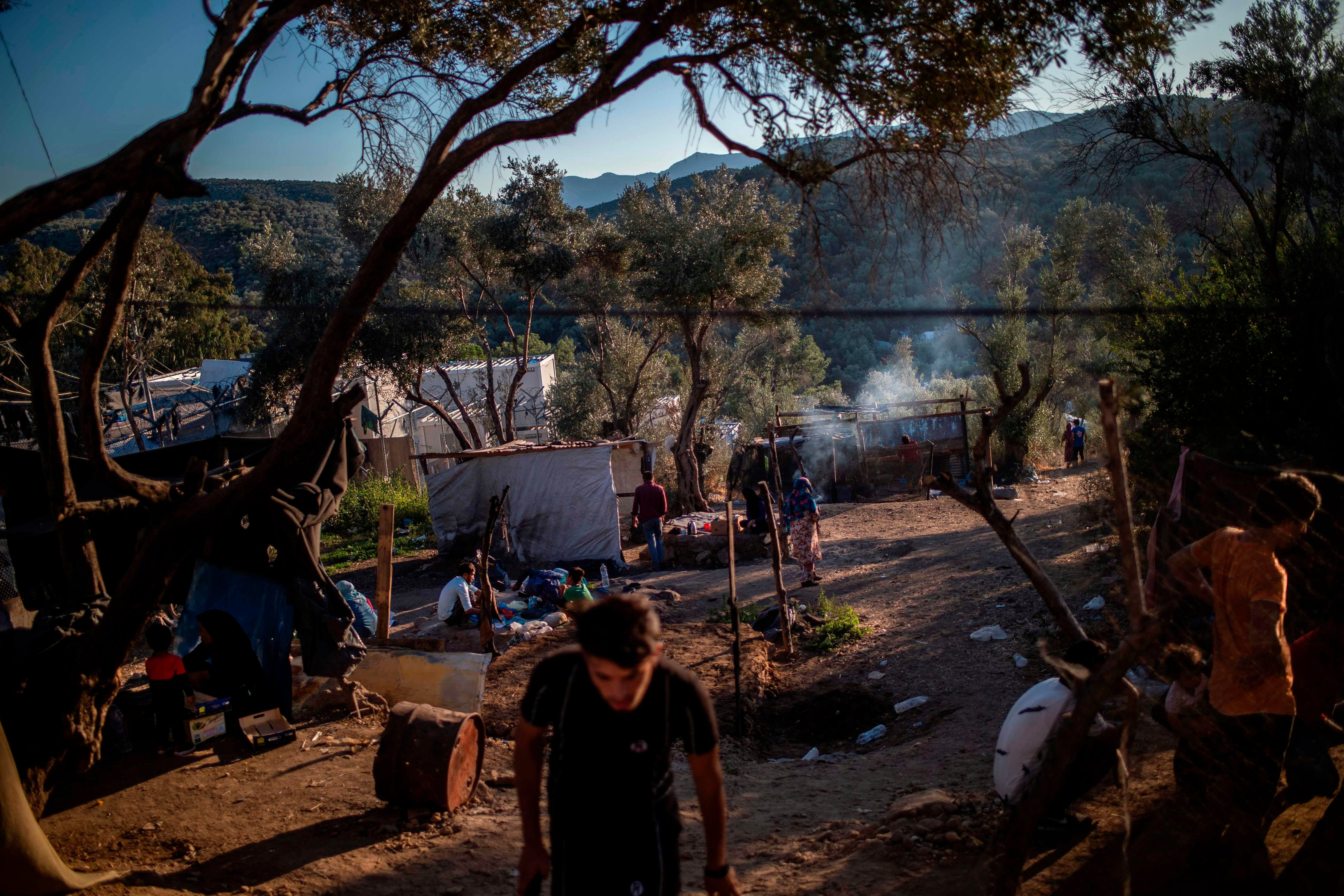 Greece announces steps to shut down notorious refugee