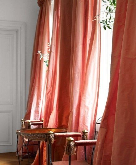 One Voluminously Draped Silk Curtain On Window (THE COLOR)