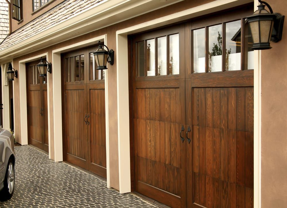 Our Expert Team Of Professionals Can Repair Almost Any Brand Material Style Or Type Of Garage Door Includi Barn Style Garage Doors New Homes House Exterior