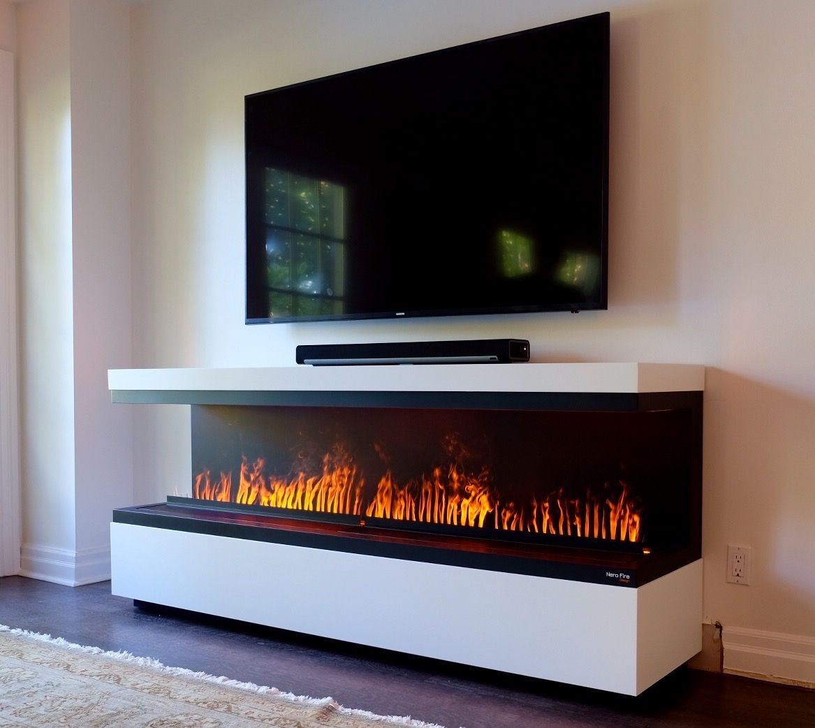 Fireplace with TV above. Water Vapor Technology Opti