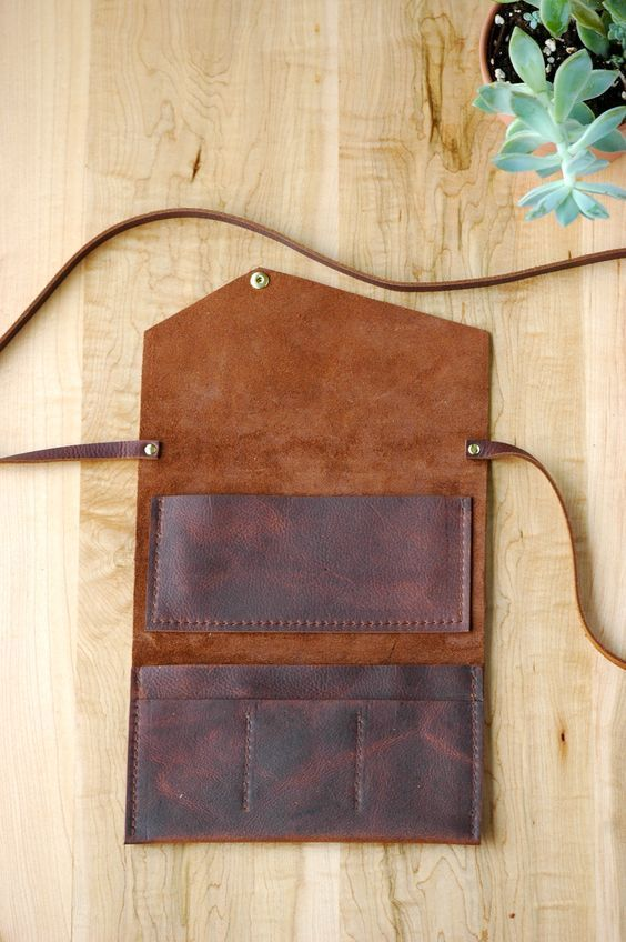 Photo of Brown leather telephone coupling   either bracelet or neck strap ladies wallet   small cape …