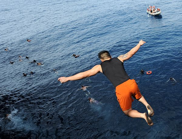 Navy News Service - Eye on the Fleet...swim anyone?...but you have to jump off an aircraft carrier first.