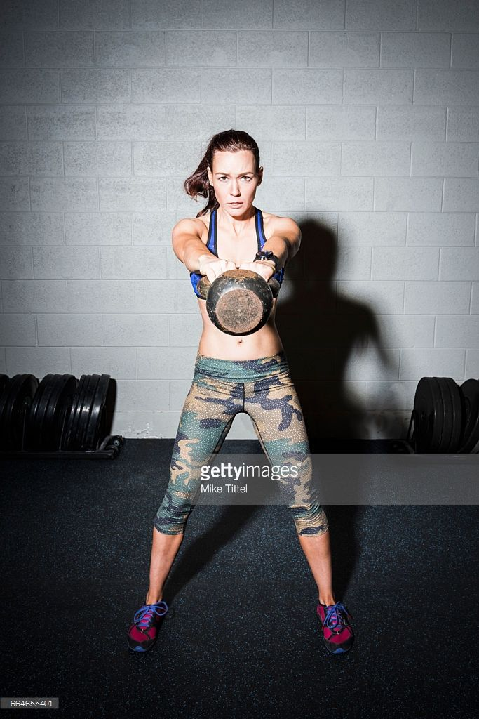 Portrait Of Young Woman Training Weight Lifting Dumbbell In
