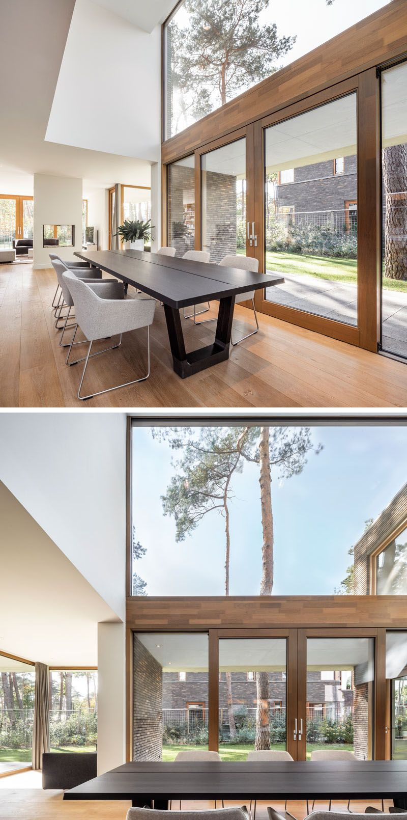 This Modern House Has A Double Height Ceiling Above Dining Table Large Windows For Plenty Of Natural Light And Wood Modern Windows Large Windows House Design