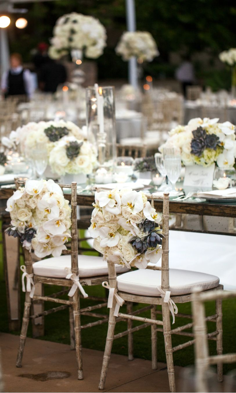 20 spectacular wedding centerpiece decor ideas to see for Decorating chairs for wedding reception