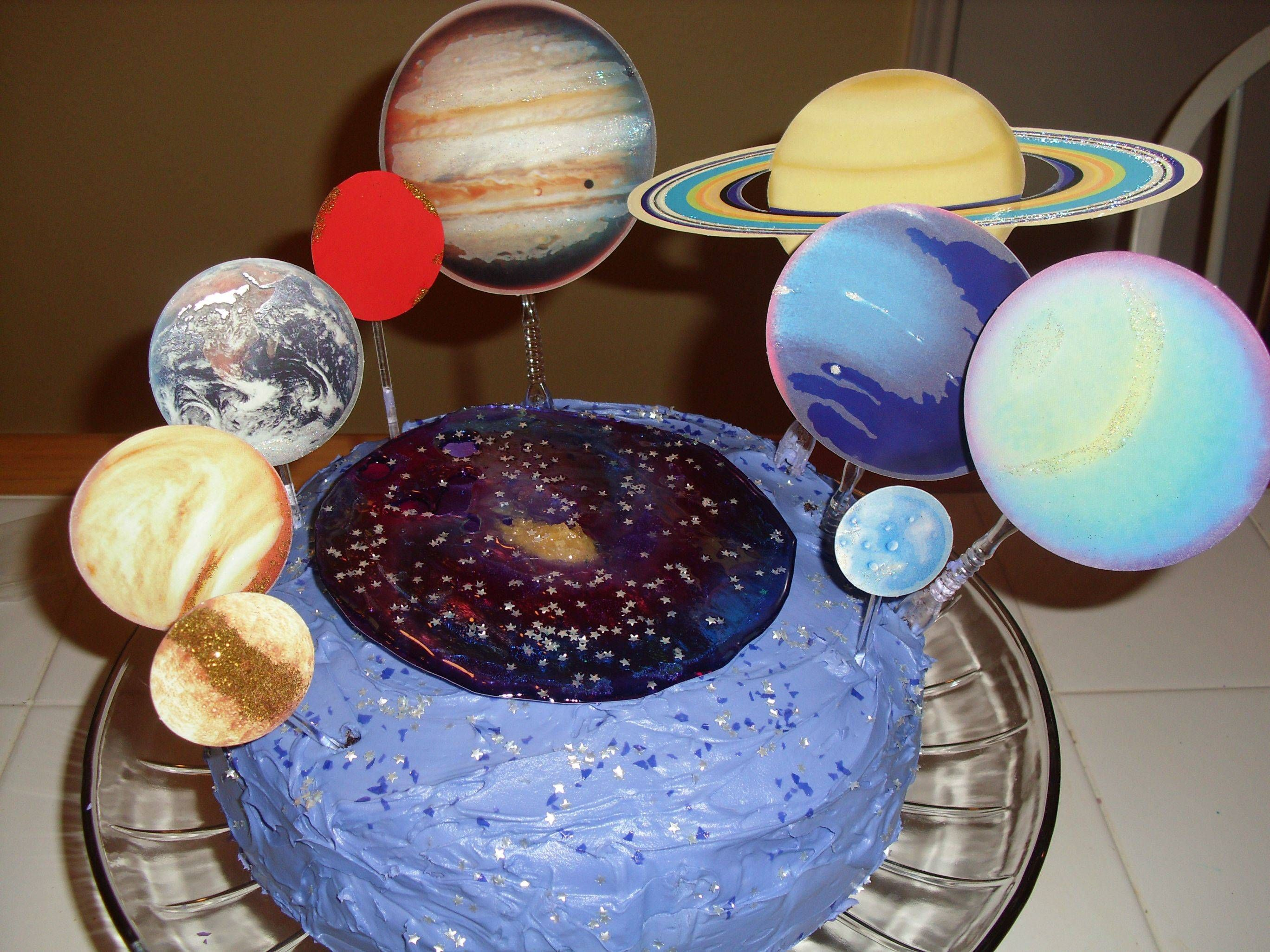 An Outer Space Birthday Cake With Melted Candy Nebula