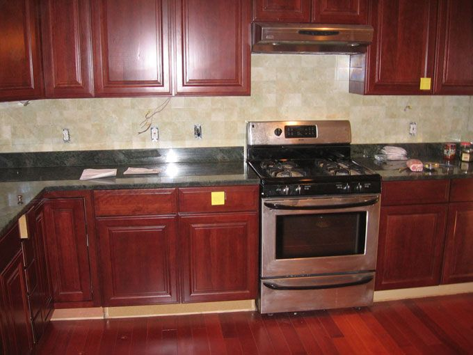 Legacy cherry cabinets with granite and ceramic tile ... on Backsplash Ideas For Black Granite Countertops And Cherry Cabinets  id=94521