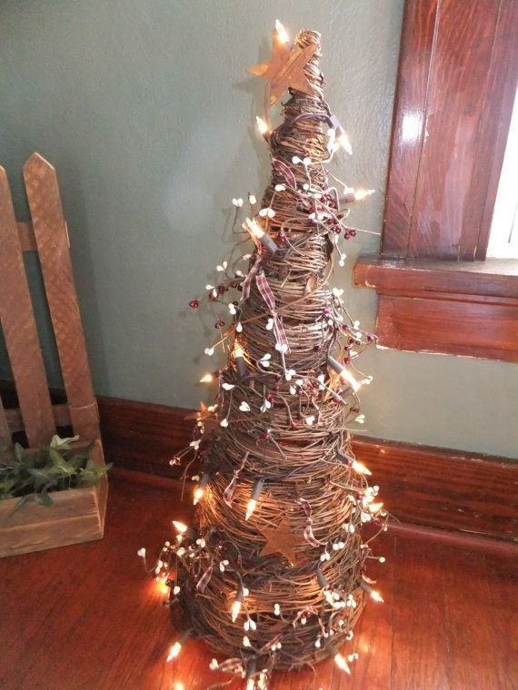 Decorated Grapevine Tree with Burgundy and Cream Berries  White Lights and  Rusty StarsPrimitive Grapevine Lighted Tree with Burgandy and Gold Pip  . Grape Vine Lighting. Home Design Ideas