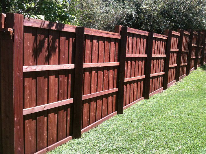 6u0027 stained cedar board on board stepped fence with top cap Fences