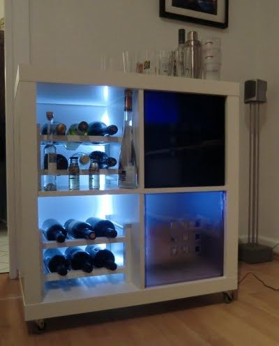a rolling minibar cobbled together from ikea pieces. to get the