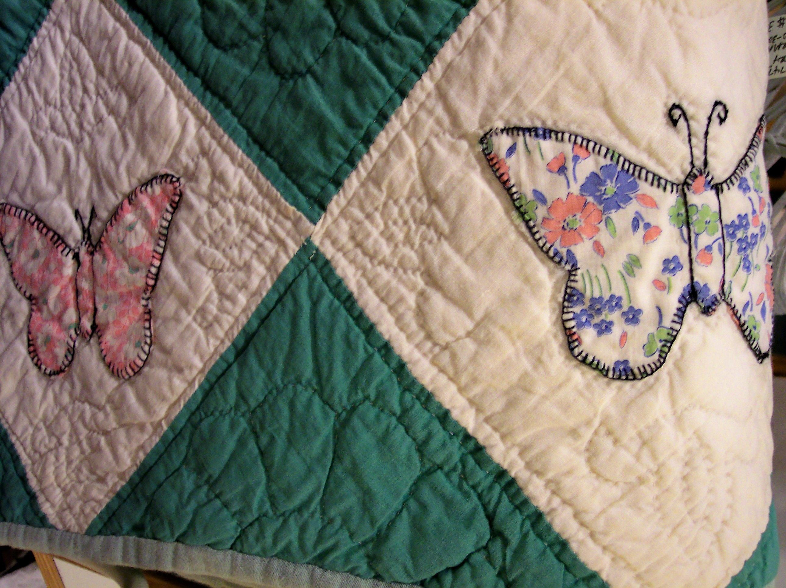 Pair of hand stitched twin size butterfly quilts