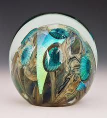 art glass paperweight with peacock eye feather motif