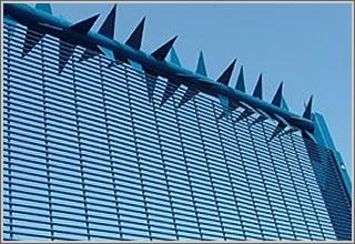 Anti climb wall spikes and rotary anti climb spike barrier