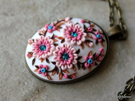 Check out this item in my Etsy shop https://www.etsy.com/listing/456928758/lovely-polymer-clay-applique-statement