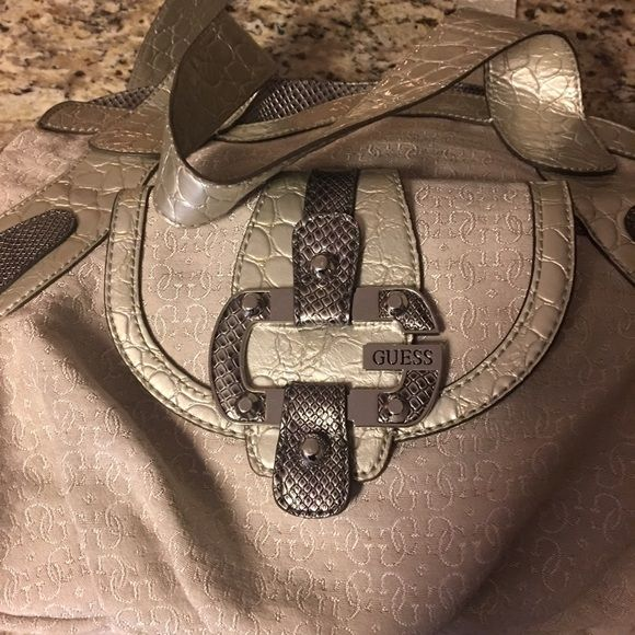 Guess bag Great condition but used. Only wear marks are shown in photo. Grey colored bag. Guess Bags Totes