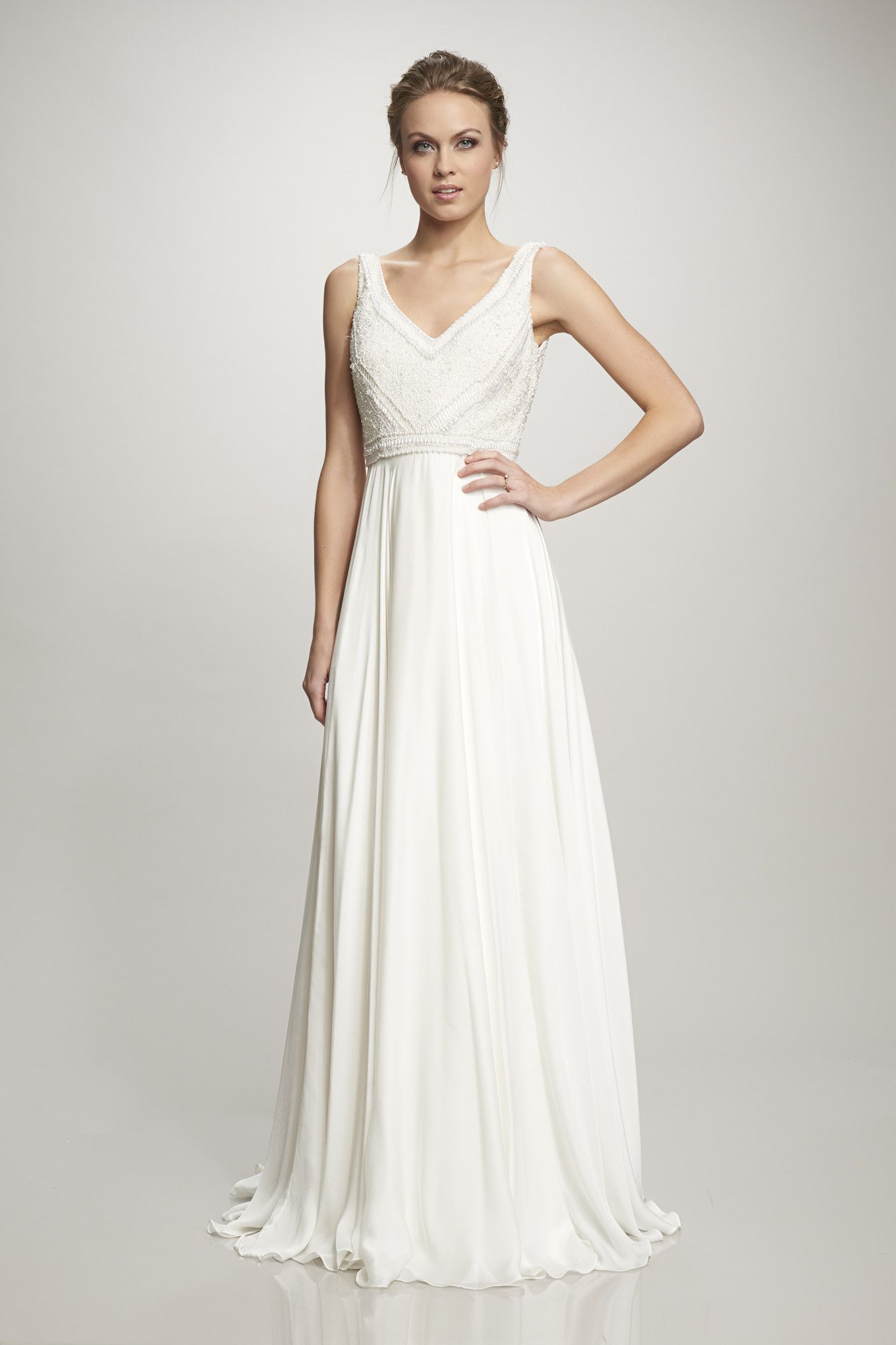 Sash and bustle ivory satin faced silk georgette gown with hand