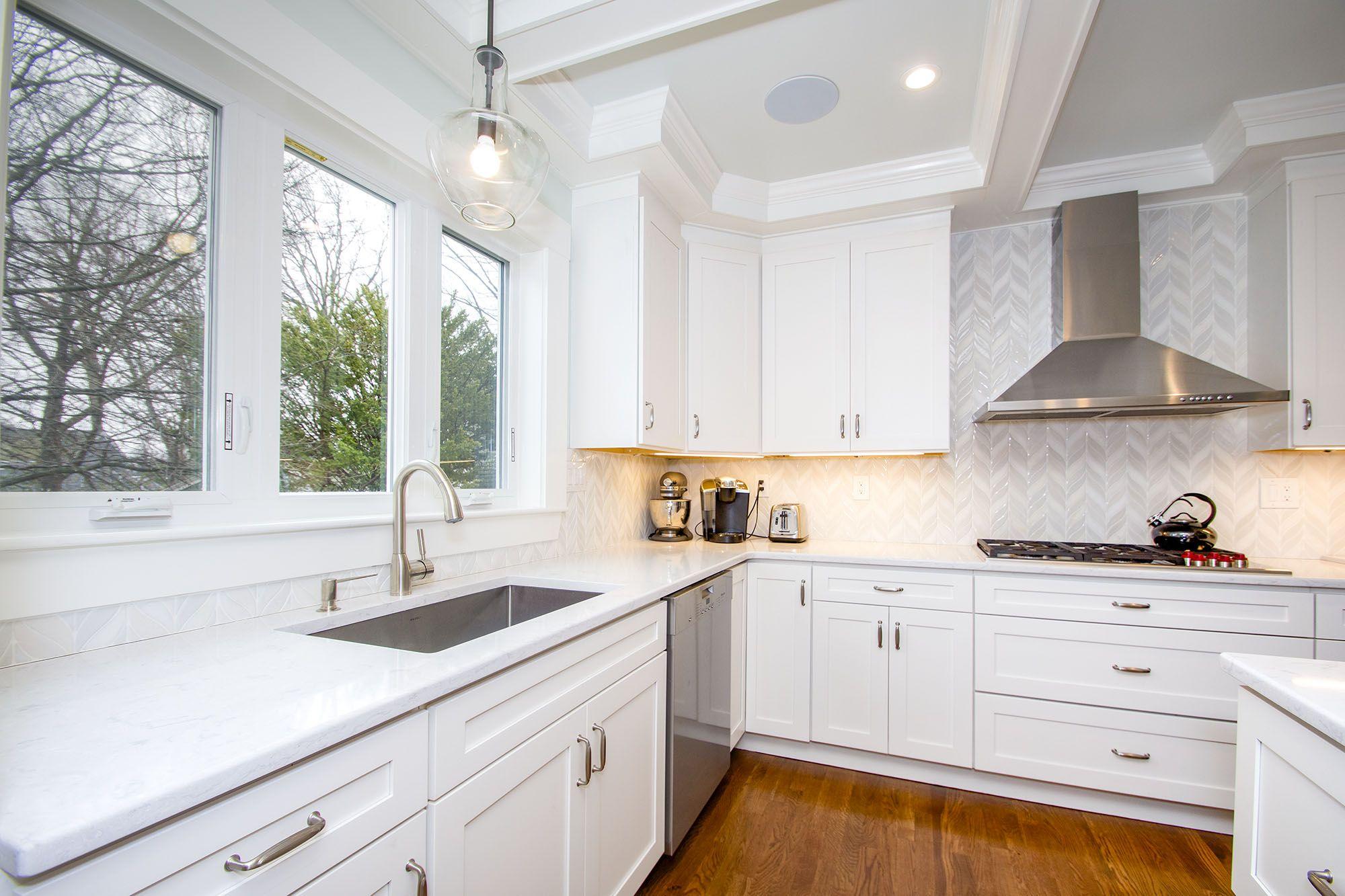 white cabinets, hardwood floors, pendant light, stainless ...