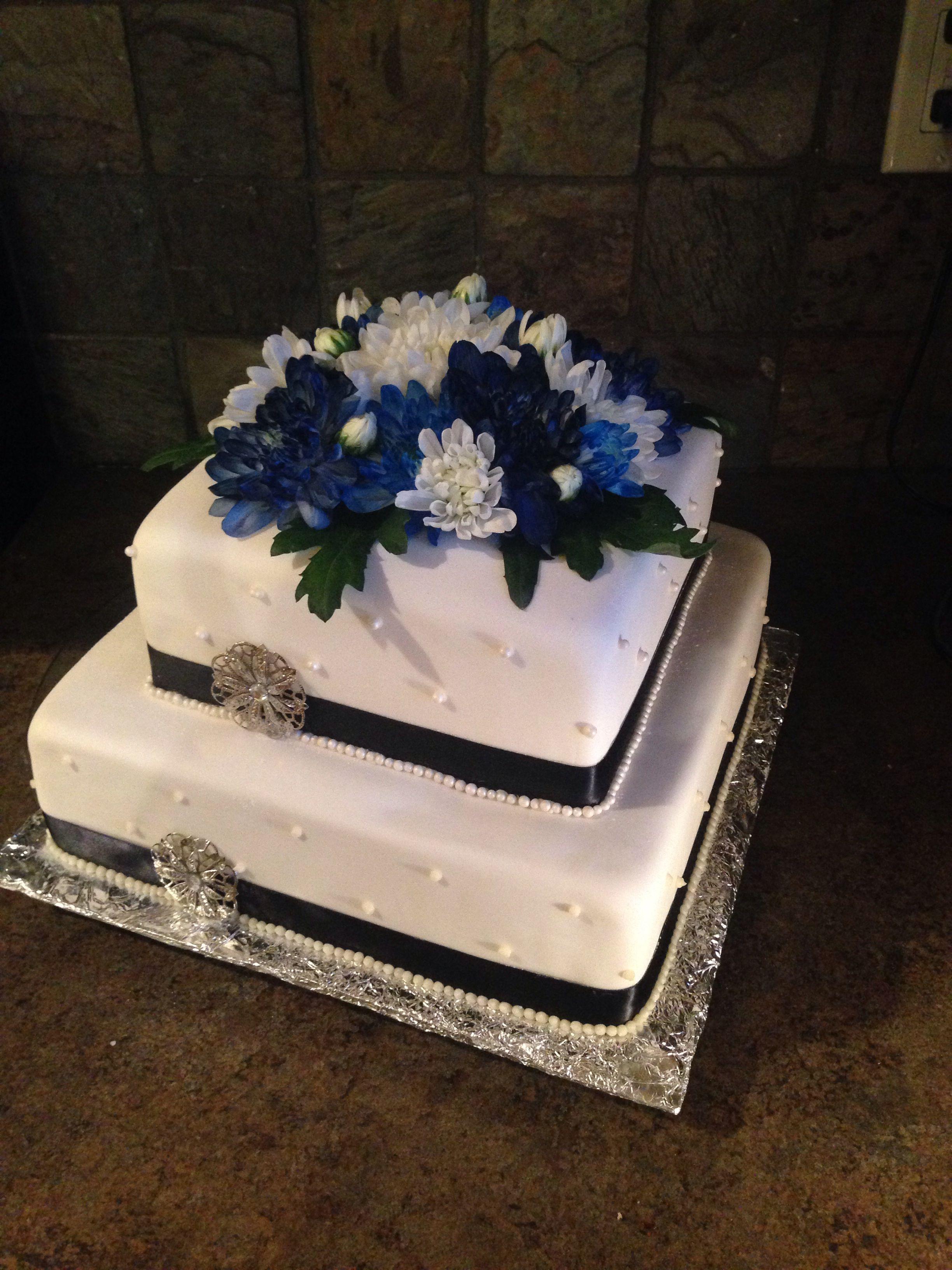 Square tiered wedding cake with blue mums birthday cake