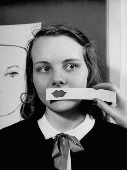 """Nina Leen - From a 1945 story on """"good grooming,"""" the caption to this picture asserted that a """"rosebud mouth is especially bad on round faces."""""""