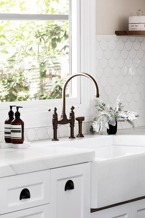 Mounted In White Cabinets Accented With Oil Rubbed Bronze