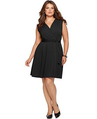 NY Collection Plus Size Sleeveless Faux-Wrap Belted Dress. A classic black wrap dress can have a lot of different looks with your jewelry and accessories