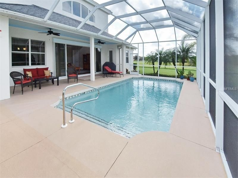 traditional swimming pool with skylight, exterior stone floors