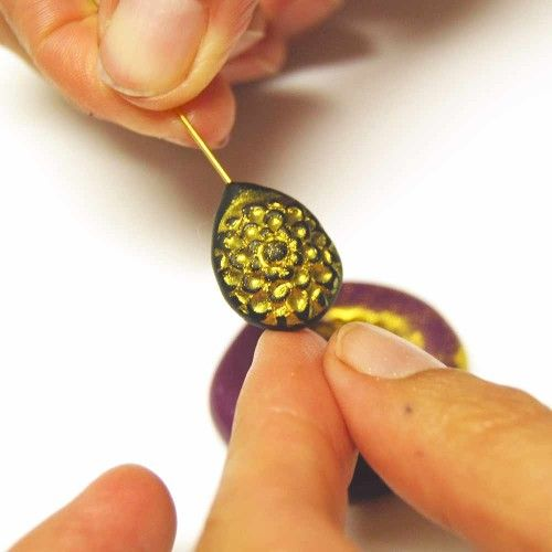 Tutorial on how to make sculpted epoxy clay decorative accents with molds and mica powders.