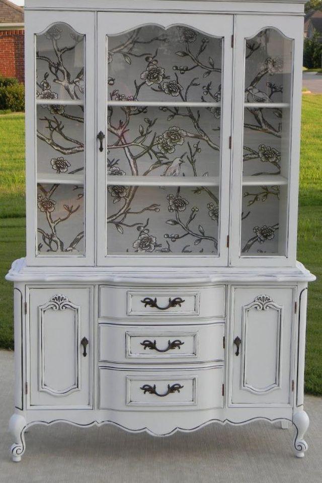 Wallpaper on inside of cabinet