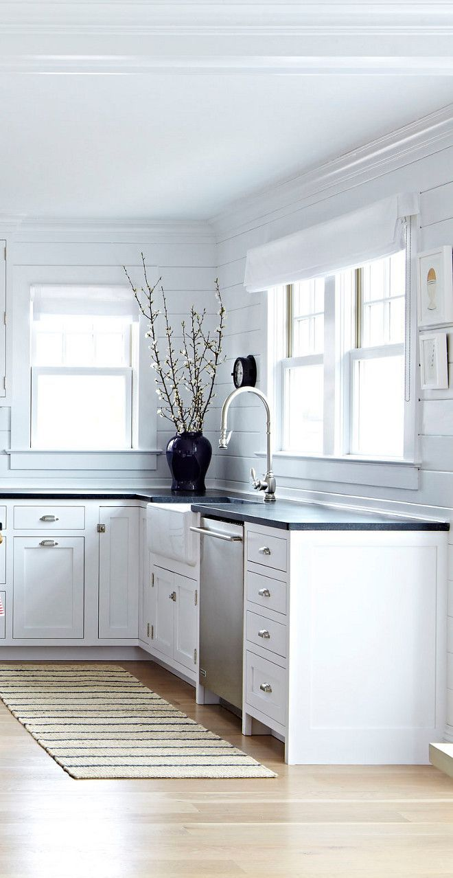 White shaker cabinets, black countertops and white shiplap walls ...