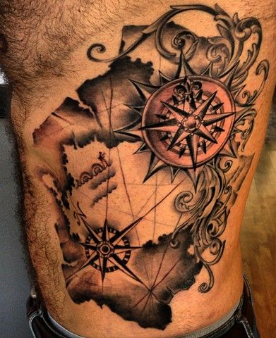Black ink map with two compass tattoo on man side rib tattoos vintage map tattoo grid lines and compasses gumiabroncs Image collections