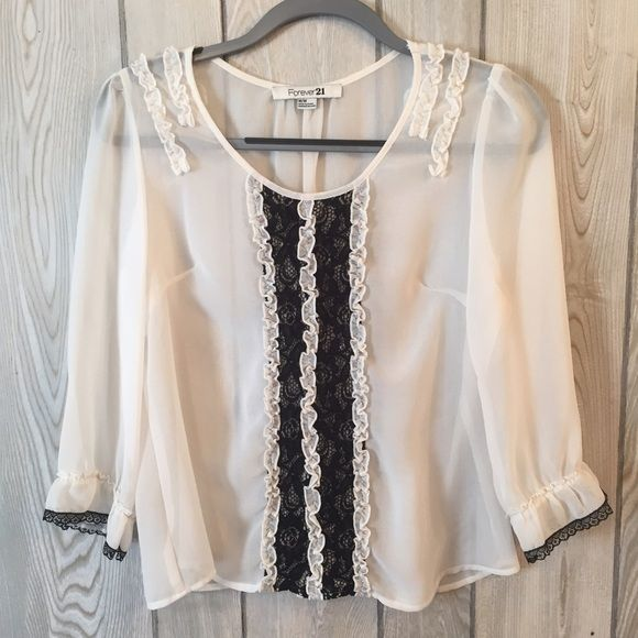 White W/ Black Lace Top Plays in perfectly with today's trends of flounce and lace. Can be dressed up with black skinny jeans and booties or dressed down with sandals. Super cute! Forever 21 Tops Blouses