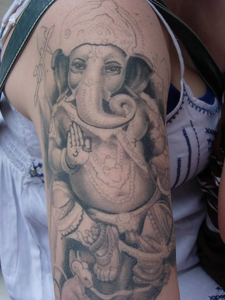 11 ganesha tattoo designs ideas and samples - Below A Uncompleted Hindu God Ganesh Tattoo Which Is Looking Pretty Cool The Ganesh Tattoo Easily Recognizable As The Elephant Deity Riding A Mouse
