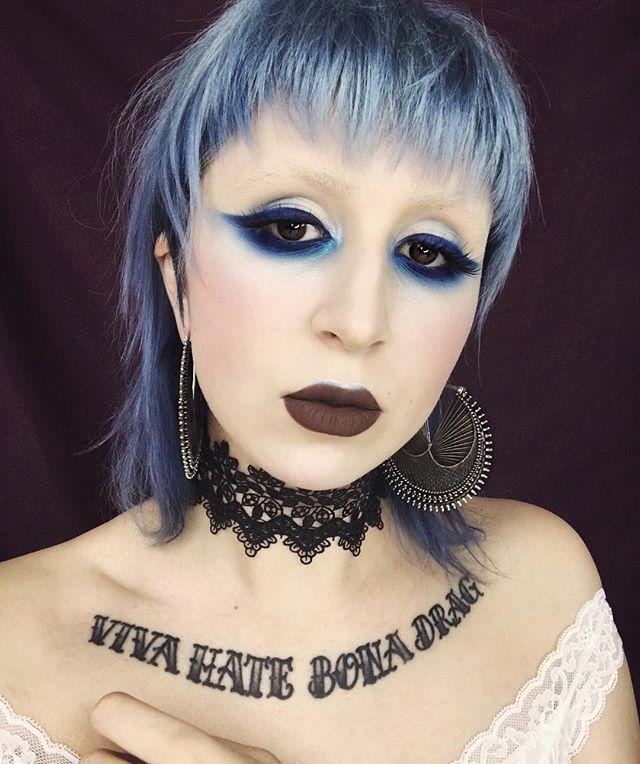 "A whole lot of my favourite things ❄️ ••••••••••••••••••••••••••••••••••••••• Eyes: @katvondbeauty Metal Matte Eyeshadow Palette + the new Alchemist Holographic Palette shade ""Blue Saphyre"" (inner corner blended to cheeks & lip) + Ink Liner ""Nerdrum"" Face: @katvondbeauty Lock-It Concealer + Lock-It Powder Foundation  Lips: @blackmooncosmetics Liquid Lipstick ""Grim"" Earrings: @mayajewelry Expo 67 Hair by @johanna.libbey at @moodshairsalon •••••••••••••••••••••••••••••••••••••• #katvondbe..."