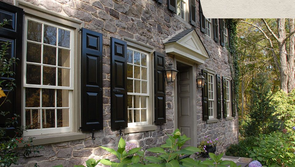 Pitch Black Panel Shutters On A Stone House Shutters Exterior