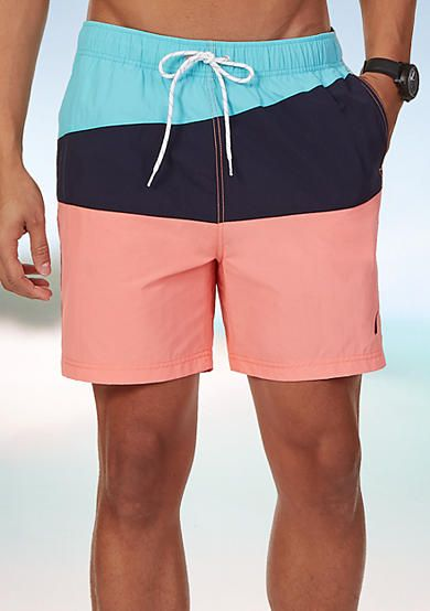 d8c108c485 Bold coral, navy, and turquoise shades create the slanted colorblock design  in these colorblock
