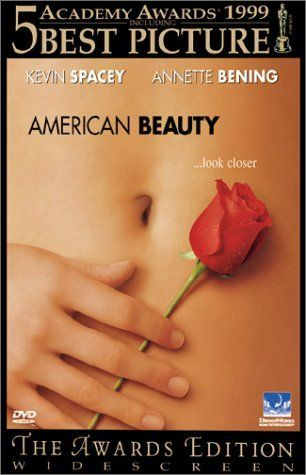 Belleza Americana (1999)  Lester Burnham, a depressed suburban father in a mid-life crisis, decides to turn his hectic life around after developing an infatuation for his daughter's attractive friend.  Director: Sam Mendes  Writer: Alan Ball  Stars: Kevin Spacey, Annette Bening and Thora Birch