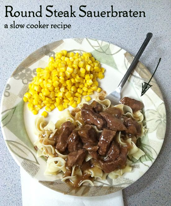 Round Steak in Crock over Noodles 1 envelope brown gravy mix 2 Tbsp plus 1.5 tsp brown sugar 2.5 cups cold water, divided 1 cup chopped onion 2 Tbsp white vinegar 2 tsp Worcestershire sauce 4 bay leaves 2.5 lbs. boneless beef top round steak, cut into 3″ x 1/2″ strips 2 tsp salt 1 tsp pepper 1/4 cup cornstarch 10 cups hot cooked egg noodles