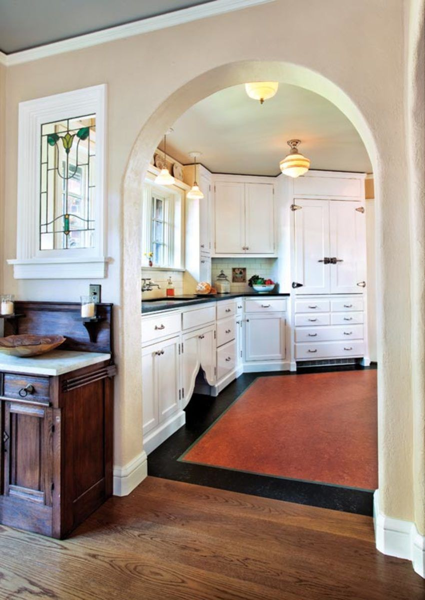 Classic White Kitchen for a 1920s Tudor. The clock gets turned back on the kitchen in a 1920s house. #kitchendesign1920shouse #kitchencrushes