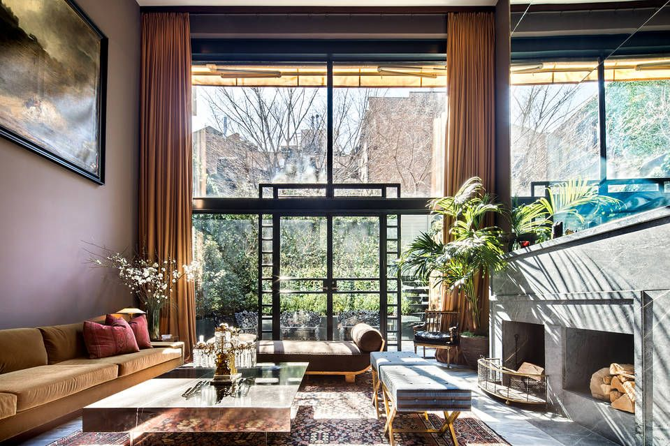 James Oakley discovered this four-story townhouse during an open house, and he was struck by the large amount of light entering the double-story living room.