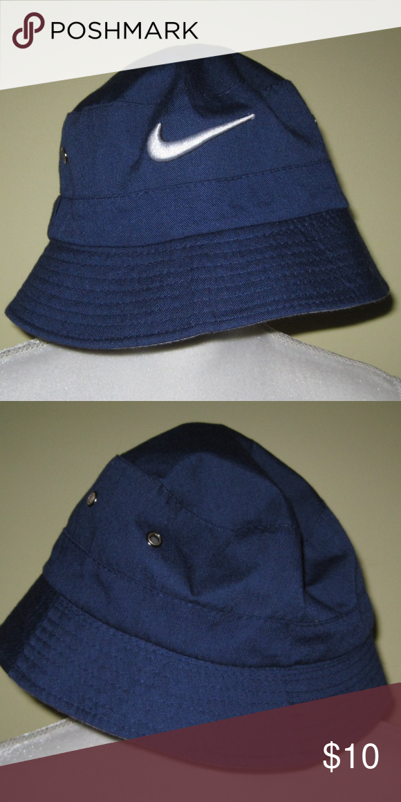 Nike Blue Bucket Hat Super cute for golfing or fishing! This is a navy blue  NIKE Bucket hat. Has white SWOOSH logo. Excellent condition! 5ee16b50995